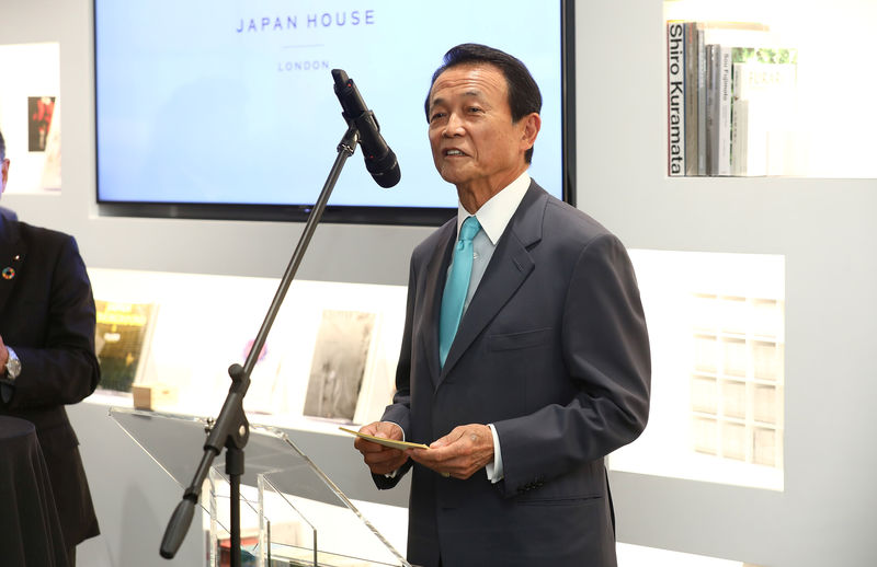 © Reuters. Taro Aso, Japan's Deputy Prime Minister, speaks at the official opening of Japan House in London