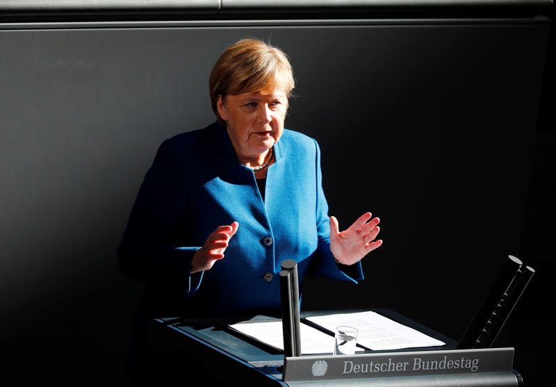 © Reuters. German Chancellor Merkel speaks during a session at the lower house of parliament Bundestag in Berlin