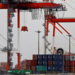 Japan downgrades view of export picture as costs of trade war rise