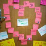 Students decorate classmate's door with inspiring messages after someone leaves a racist note