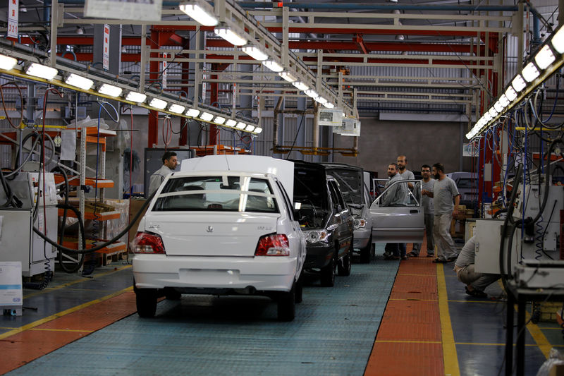 © Reuters. Cars are seen inside the Saipa Syria Factory in the industrial city of Hassia in Homs
