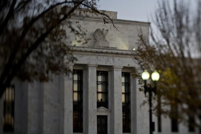 © Bloomberg. (EDITORS NOTE: Image was created using a variable planed lens.) The Marriner S. Eccles Federal Reserve building stands in Washington, D.C., U.S., on Friday, Nov. 18, 2016. Federal Reserve Chair Janet Yellen told lawmakers on Thursday that she intends to stay in the job until her term expires in January 2018 while extolling the virtues of the Fed's independence from political interference. Photographer: Andrew Harrer/Bloomberg