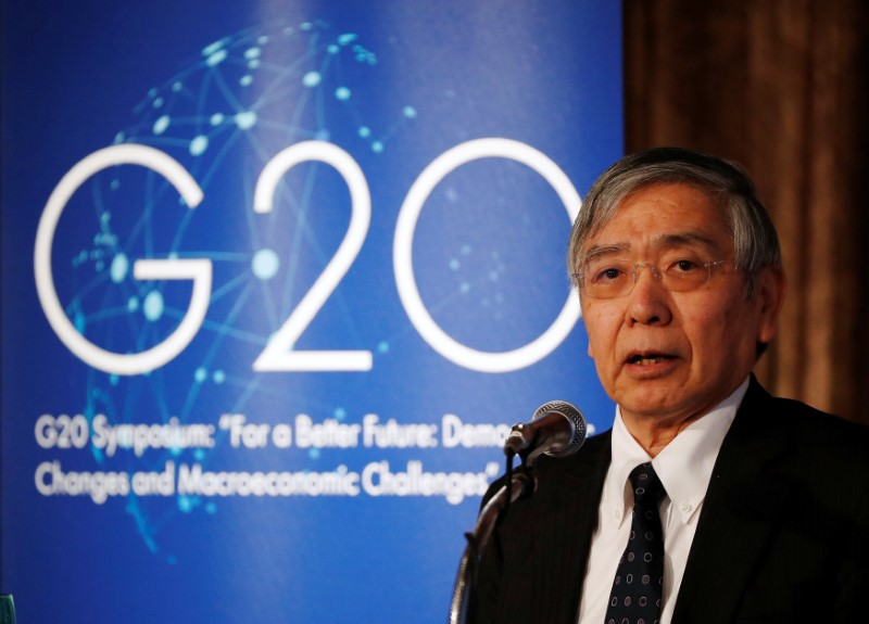 © Reuters. Bank of Japan Governor Haruhiko Kuroda delivers a keynote speech at a G20 symposium on demographic change in Tokyo