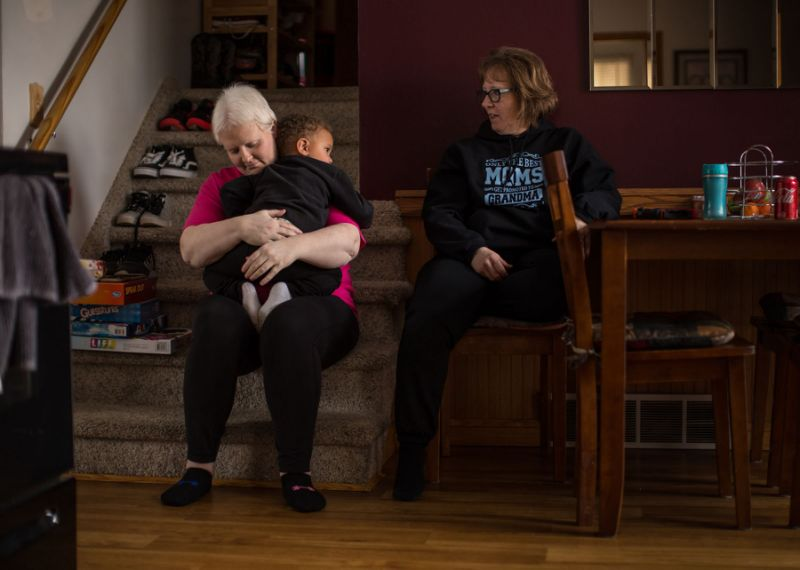 Kim Voelker-Wesley, 41, of Montrose hugs her son Cameron Wesley, 3, as her mother Terrie Gronau of Montrose looks on while sitting in the dining room of her home in Montrose on Thursday, January 3, 2019. Voelker-Wesley is battling skin cancer that spread to her breast, lungs and liver after being in remission for five years. The disease has robbed her of her livelihood and independence, but not her hopes. She has one New Year's Resolution: to live.