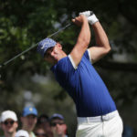 Day gets up off deck to climb into share of Masters lead