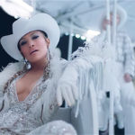 Jennifer Lopez Hits The Dance Floor In A Glittering Dress W/ Thigh-High Slit For 'Medicine' Music Video