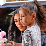 North West Struggles To Carry Chicago In Kim Kardashian's Heels At True Thompson's 1st Bday