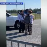 Heartwarming video shows police officer help student fix tie ahead of high school graduation