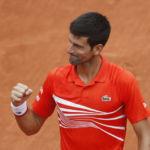 Djokovic reaches 10th successive French Open quarter-final