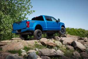 a blue truck that is sitting on a rock: 2020 Ford Super Duty Tremor package