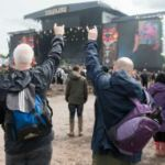 Watch Download Festival fans bow down to 'The Mud King'