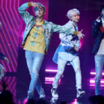 BTS' Jin Debuts Purple Hair Ahead Of Wembley Show & Fans Are Loving It