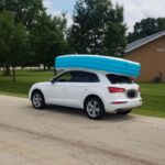 Mom arrested after allegedly driving with daughters sitting in inflatable pool attached to the roof of her car