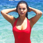 Selena Gomez Stuns In Black Swimsuit On Beach Bachelorette Trip With Cousins & Girlfriends – See Pic