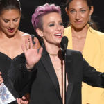 Megan Rapinoe Suffers Wardrobe Malfunction As Her Blazer Falls Open & She Has Nothing Beneath