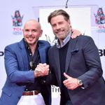 Surprise! Pitbull's '3 To Tango' Video Stars A Bald, Dancing John Travolta