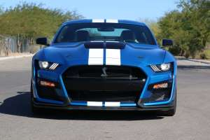 a blue car parked on the side of a road: 007-2020-GT500-Shelby-Mustang-Camaro-5-Things-1.jpg