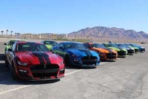 a car parked in a parking lot: 009-2020-GT500-Shelby-Mustang-Camaro-5-Things-1.jpg