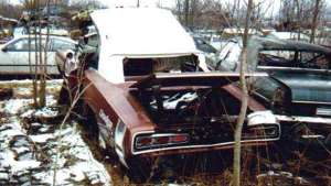 a car parked in a yard: 035-1970-dodge-coronet-rt-vintage-yard