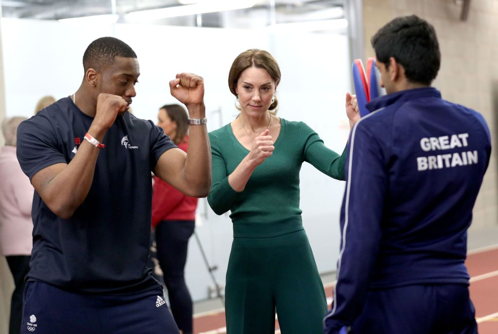 Catherine Duchess of Cambridge is shown Taekwondo moves by Great Britain's Lutalo Muhammad (left), during a SportsAid event at the London Stadium in StratfordCatherine Duchess of Cambridge attends a SportsAid event, Stratford, London, UK - 26 Feb 2020