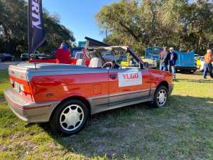 a truck is parked in the grass: Concours d'Lemons Amelia Island