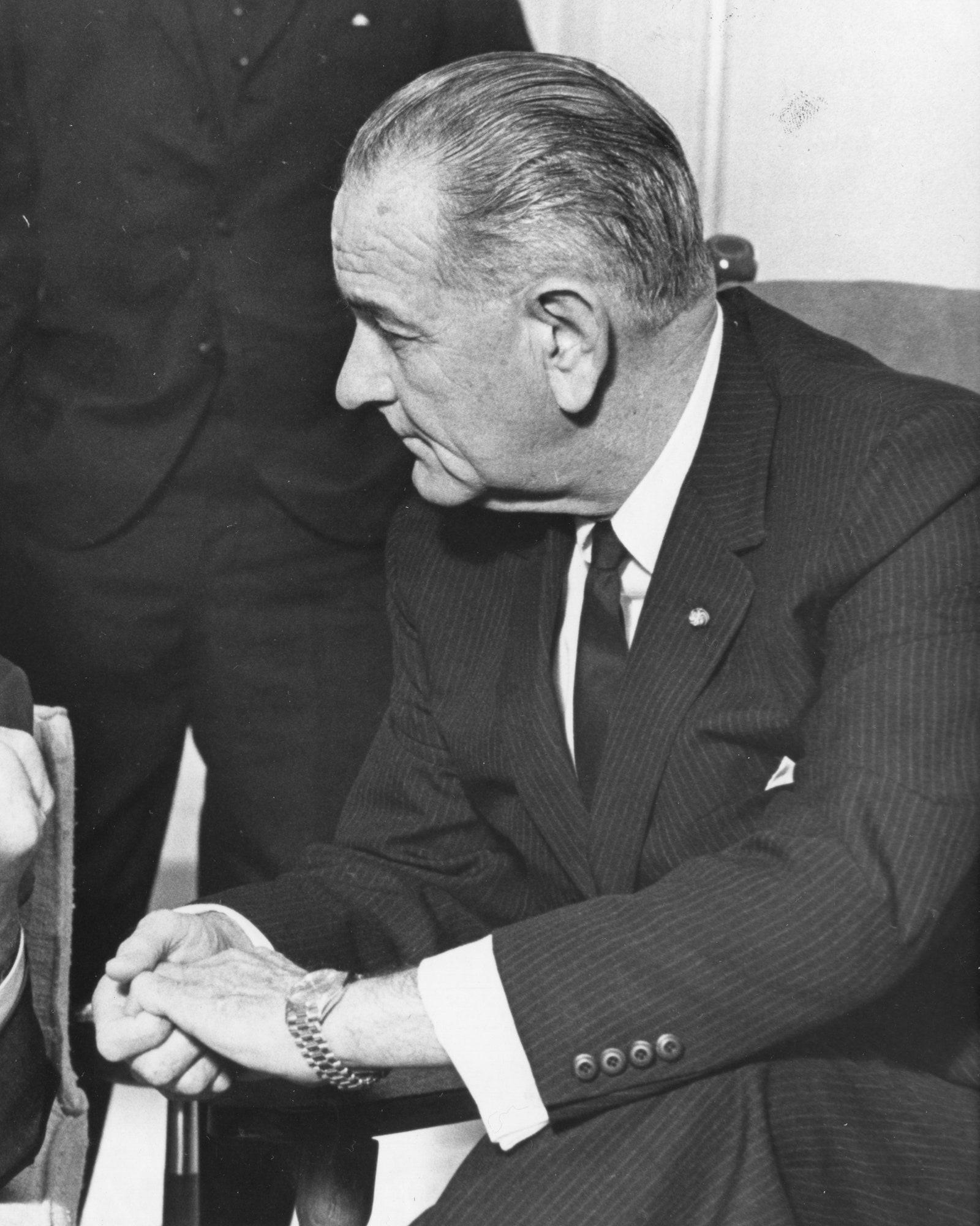 President Lyndon B Johnson listens to VicePresident Hubert H Humphrey's report of his fiveday Far East tour Washington...