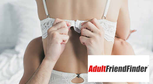Couple kissing in bed, adult friend finder logo overlay