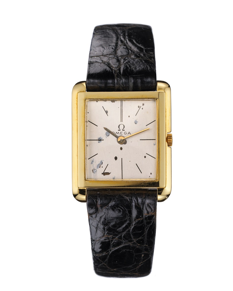 A gold square watch