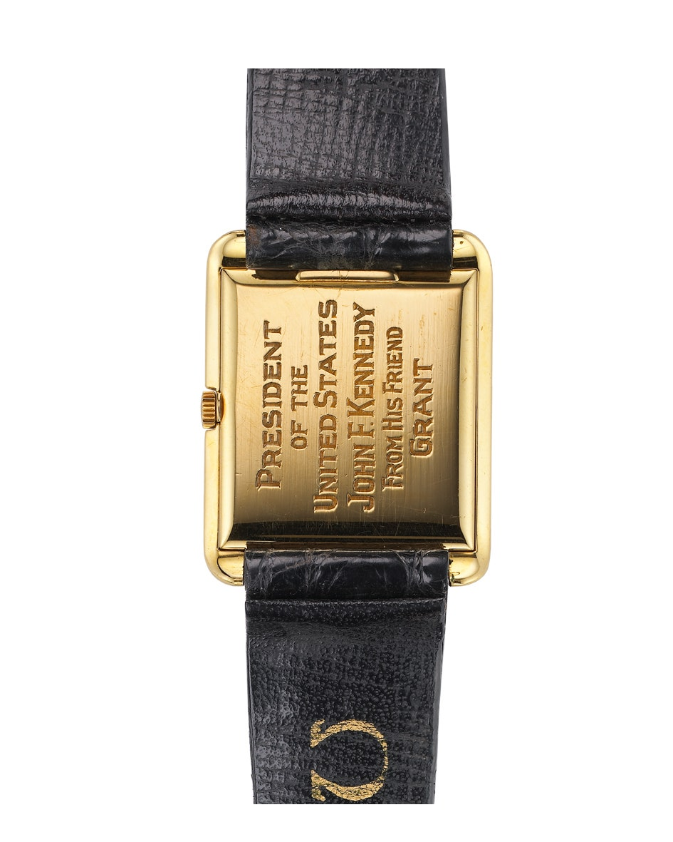 The back case of a gold square watch
