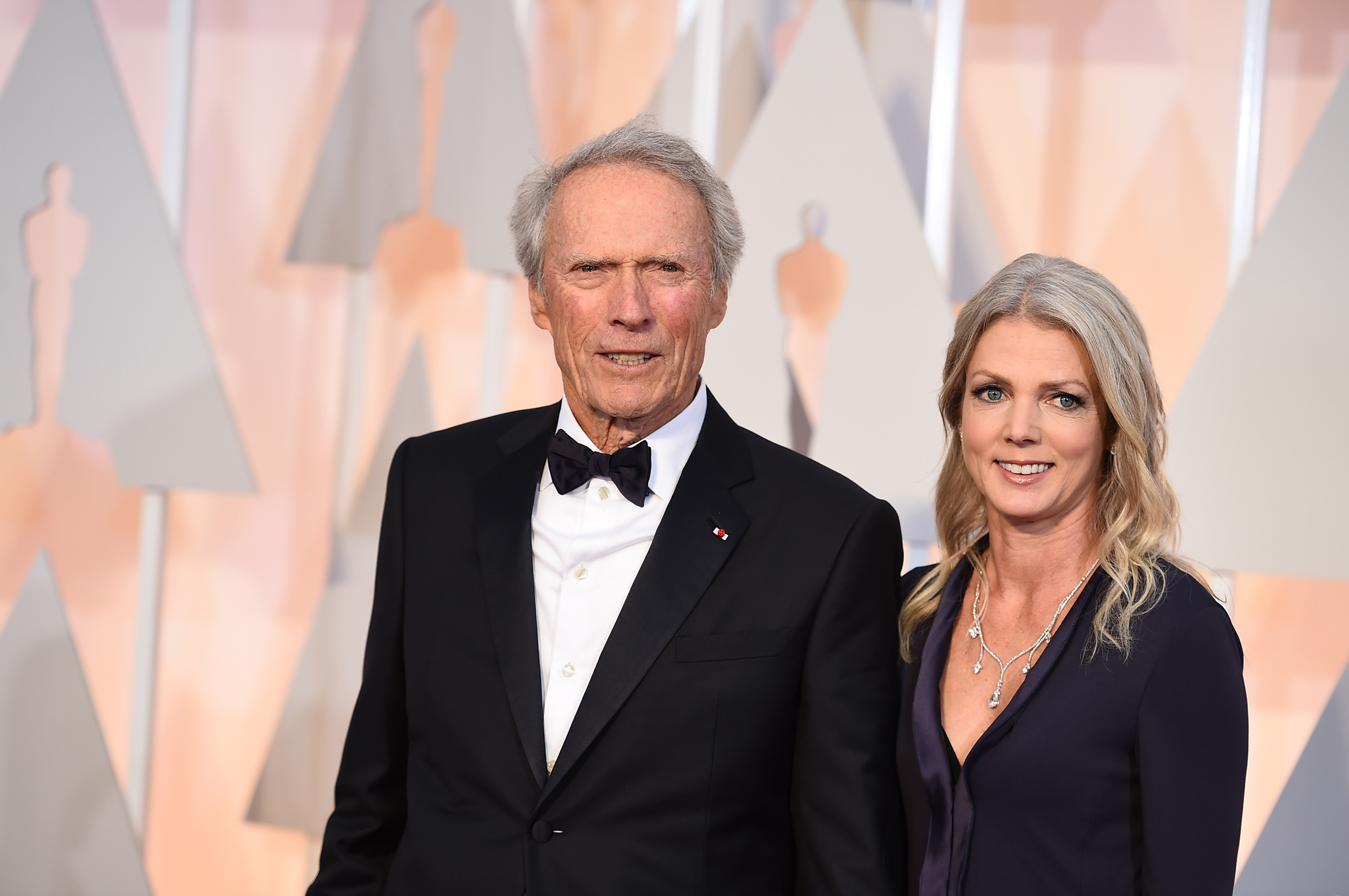 Clint Eastwood, left, and Christina Sandera arrive at the Oscars, at the Dolby Theatre in Los Angeles87th Academy Awards - Arrivals, Los Angeles, USA