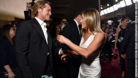 Exes Brad Pitt (left) and Jennifer Aniston share a moment at the 26th Annual Screen ActorsGuild Awards at The Shrine Auditorium on January 19 in Los Angeles.